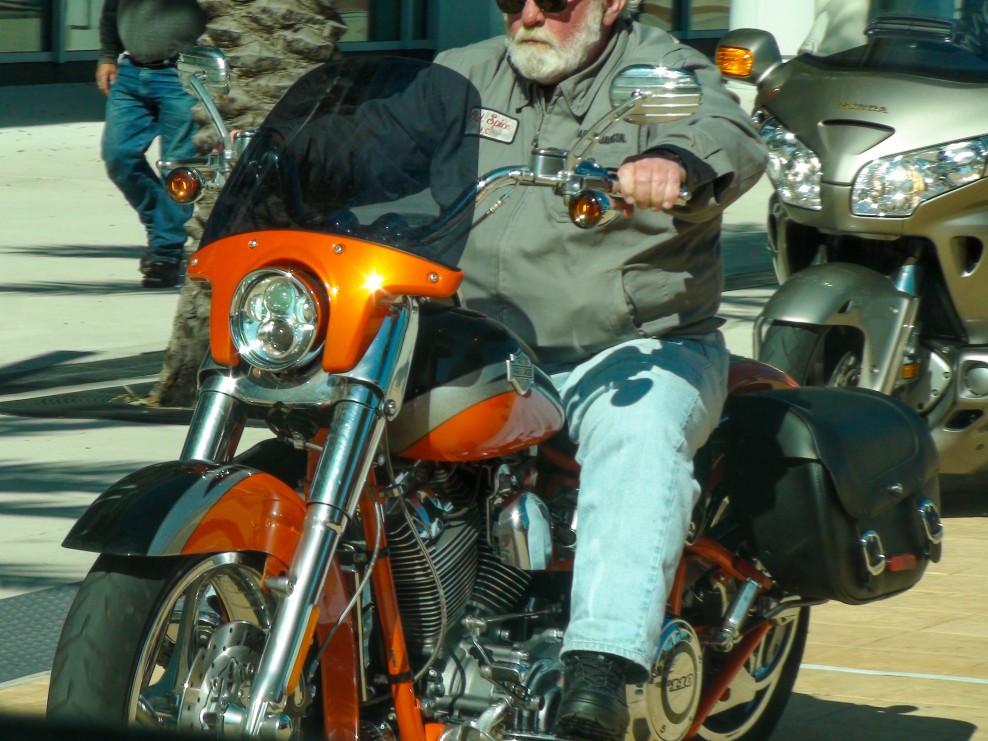 biker man on harley davidson cvo softail convertible screaming