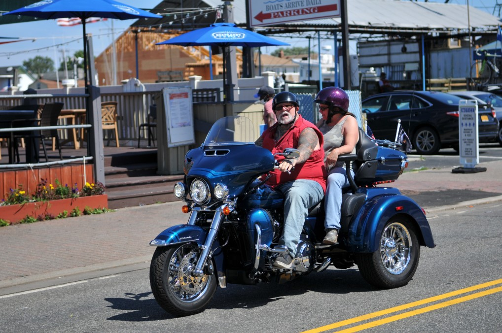 blue harley davidson tri glide 18 wheel billet motorcycle with two riders
